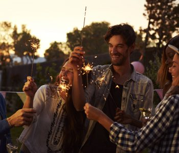 Group Of Friends With Sparklers Enjoying Outdoor Party